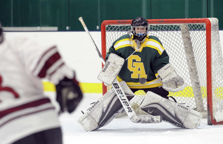 Goalie Annie DeFrino of Greenwich Academy makes a stop during the girls high school hockey game between Greenwich Academy and The Gunnery at Chelsea Piers in Stamford, Wednesday afternoon, Jan. 16, 2013. Photo: Bob Luckey / Greenwich Time