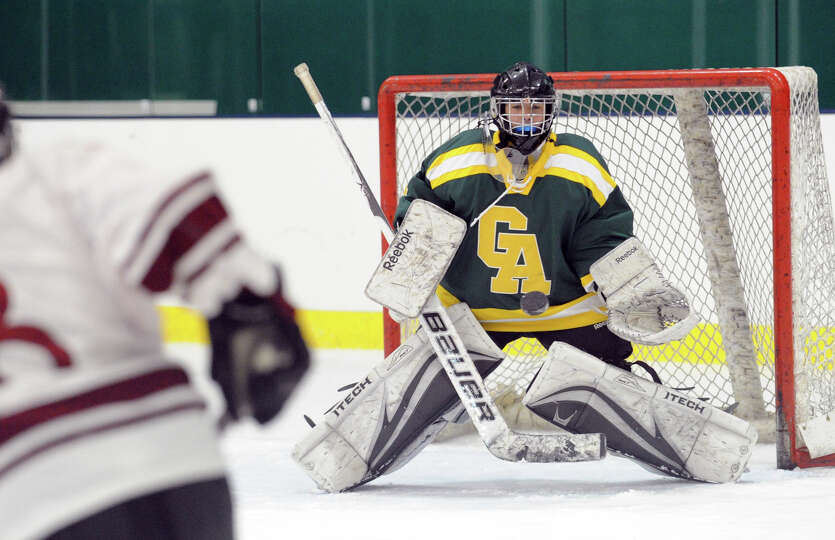 Goalie Annie DeFrino of Greenwich Academy makes a stop during the girls high school hockey game betw