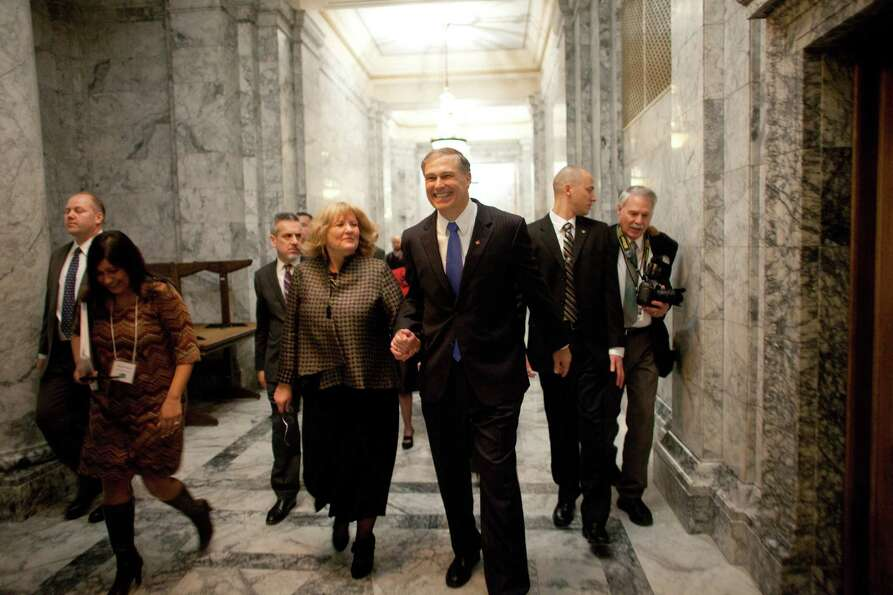 Washington State Governor Jay Inslee walks the halls of the Capitol with his wife Trudi.