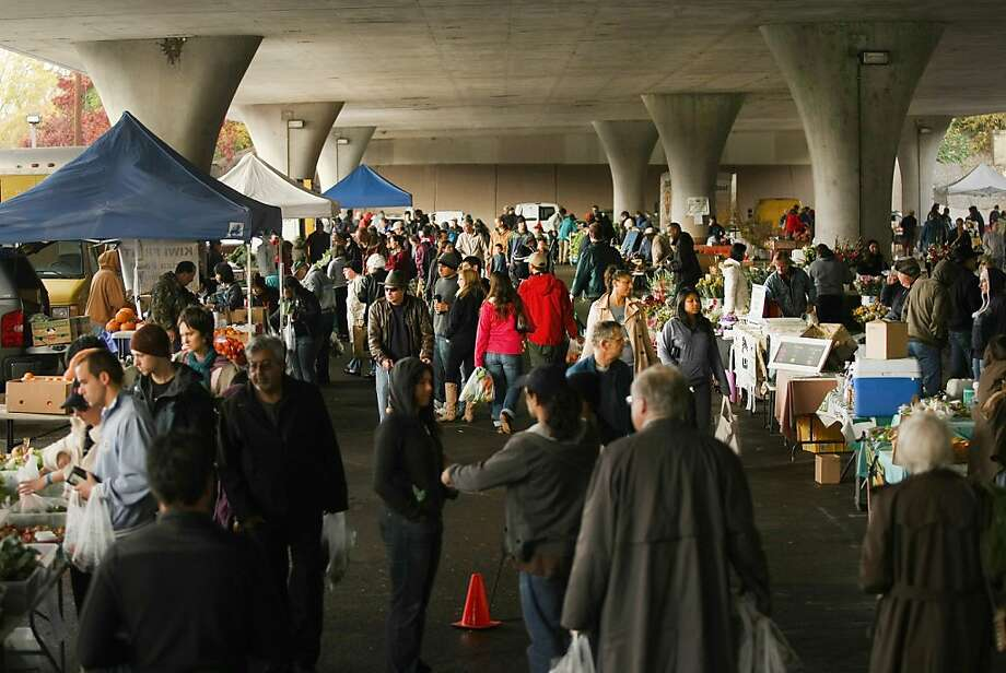 People shop at the farmers' market under Highway 50 at Eighth and W streets in downtown Sacramento. Photo: Kurt Hegre, Special To The Chronicle