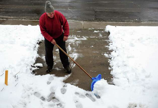Joe Napychank shovels the walkway to his Ansonia, Conn. home Wednesday, Jan. 16, 2013. Photo: Autumn Driscoll / Connecticut Post