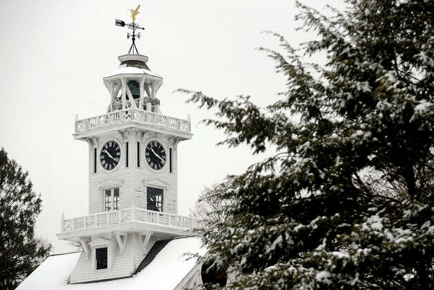 The clock tower in Boothe Memorial Park, in Stratford, Conn. on a snowy morning, Jan 16th, 2013. Photo: Ned Gerard / Connecticut Post
