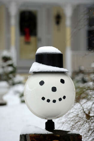 A snowman light in front of a home on Patterson Ave., in Stratford, Conn. on a snowy morning, Jan. 16th, 2013. Photo: Ned Gerard / Connecticut Post
