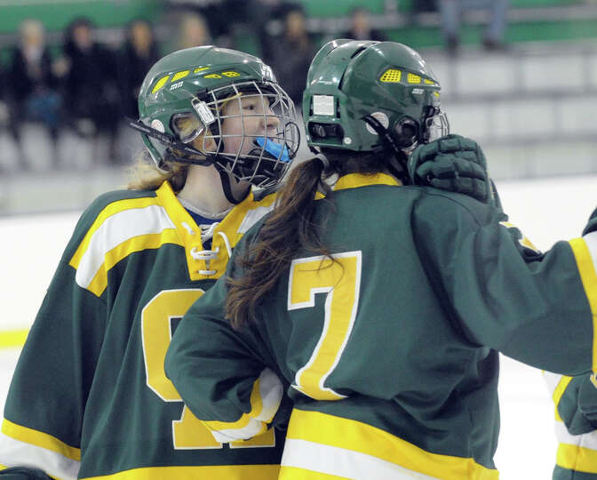 At left, Sarah Kaplan # 17 of Greenwich Academy congratualtes teammate Pam Schulman after Schulman s