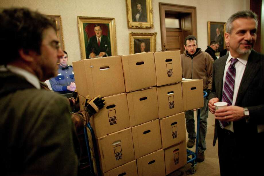 Boxes are wheeled into the Governor's Office after the inauguration of Washington State Governor Jay Inslee. Photo: JOSHUA TRUJILLO, SEATTLEPI.COM / SEATTLEPI.COM