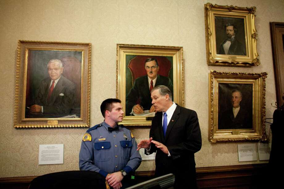 Washington State Governor Jay Inslee introduces himself to Washington State Trooper Nathan Parent in the Governor's Office. Photo: JOSHUA TRUJILLO, SEATTLEPI.COM / SEATTLEPI.COM