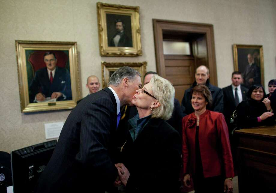 Washington State Governor Jay Inslee embraces outgoing Governor Chris Gregoire in the Governor's Office after he was sworn in. Photo: JOSHUA TRUJILLO, SEATTLEPI.COM / SEATTLEPI.COM