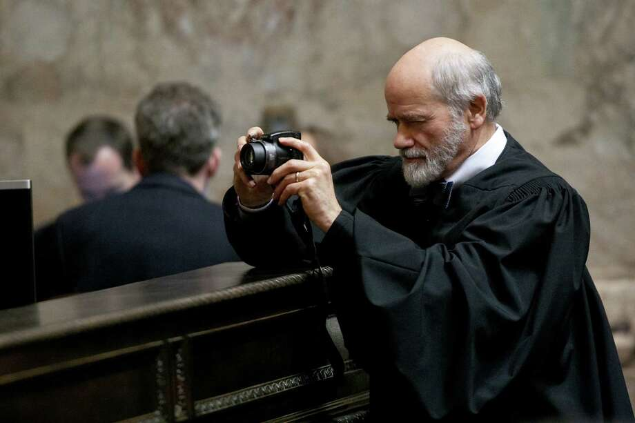 Supreme Court Justice Charles Wiggins takes a photo as elected officials are sworn in. Photo: JOSHUA TRUJILLO, SEATTLEPI.COM / SEATTLEPI.COM