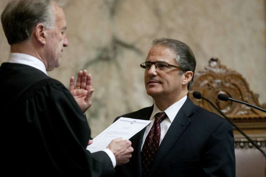 Lt. Governor Brad Owens takes the oath of office. Photo: JOSHUA TRUJILLO, SEATTLEPI.COM / SEATTLEPI.COM