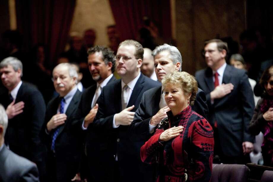 Legislators listen to the National Anthem. Photo: JOSHUA TRUJILLO, SEATTLEPI.COM / SEATTLEPI.COM