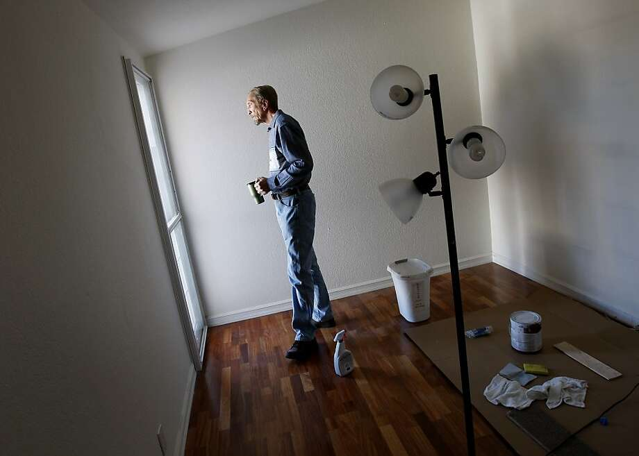 Hayward homeowner Jon Walawitch looked out the window in a bedroom he is remodeling as he prepares to put his home on the market. Median home sale prices in the nine-county Bay Area market consistently increased throughout 2012 creating a sellers market. Photo: Brant Ward, The Chronicle