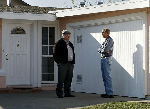 Realtor Glen Bell (left) and home owner Jon Walawitch (right) talked in front of Walawitch's Hayward home which will soon go on the market. Median home sale prices in the nine-county Bay Area market consistently increased throughout 2012 creating a sellers market. Photo: Brant Ward, The Chronicle