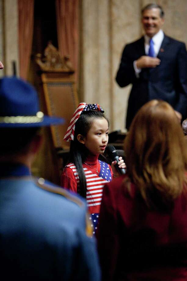 Lena Hou, 9, sings the National Anthem before the inaugural address. Photo: JOSHUA TRUJILLO, SEATTLEPI.COM / SEATTLEPI.COM