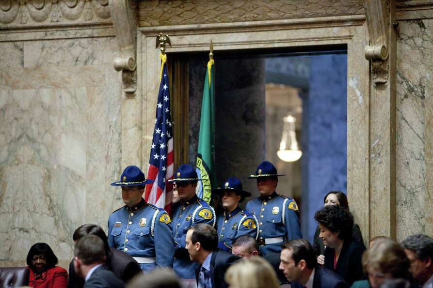 A Washington State Patrol Color Guard stands at attention before the inaugural address of Governor J