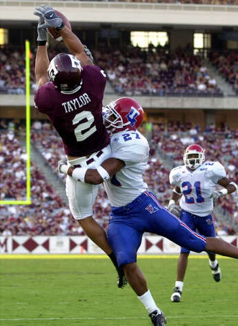 Texas A&M receiver Jamar Taylor (2) hauls in a touchdown pass in front of Louisiana Tech's Lee Johnson (27) to put the Aggies on the board on Sept. 28, 2002 at Kyle Field. Photo: San Antonio Express-News File Photo / SAN ANTONIO EXPRESS NEWS