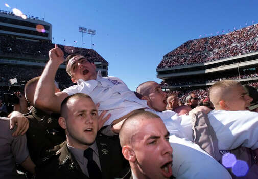 A&M Head Yell Leader Jeff Bailey is carried off the field by Corps members after A&M defeated Texas with a final score of 20-16 at Kyle Field on Nov. 26, 1999. Photo: Edward A. Ornelas, San Antonio Express-News