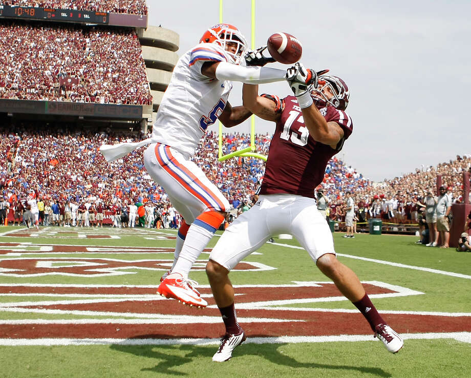 Florida defensive back Marcus Roberson (5) breaks up a pass intended for Texas A&M wide receiver Mike Evans (13) during the first quarter on Sept. 8, 2012, at Kyle Field in College Station. Photo: Nick De La Torre, Houston Chronicle / © 2012  Houston Chronicle