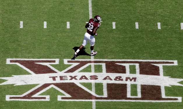 Texas A&M running back Cyrus Gray (32) runs across the Big 12 logo on Kyle Field before a game against Oklahoma State on Sept. 24, 2011. Photo: David J. Phillip, Associated Press / AP