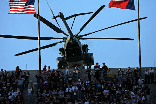 A Navy helicopter doing a flyover clears the stands on the north end of Kyle Field in College Station during opening ceremonies for the Texas A&M-Kansas football on Oct. 27, 2007. Photo: Tom Reel, San Antonio Express-News / SAN ANTONIO EXPRESS-NEWS