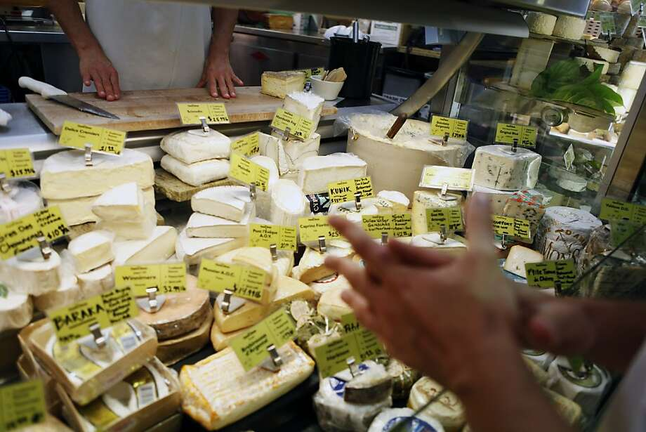Cut cheeses wrapped in plastic at retail stores can become stale. Photo: Sonja Och, The Chronicle