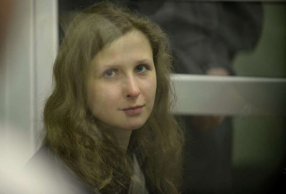 Jailed feminist punk band Pussy Riot member Maria Alekhina is seen in a cell at a court room in the town of Berezniki, some 1500 km (940 miles) north-east of Moscow, Russia, on Wednesday, Jan. 16, 2013. A Russian court on Wednesday turned down her attempt to defer serving her sentence until her preschool son becomes a teenager. Alekhina  was convicted last year along with two other band members of hooliganism motivated by religious hatred for an anti-President Vladimir Putin stunt in Russia's main cathedral. (AP Photo/Alexander Agafonov) Photo: Alexander Agafonov