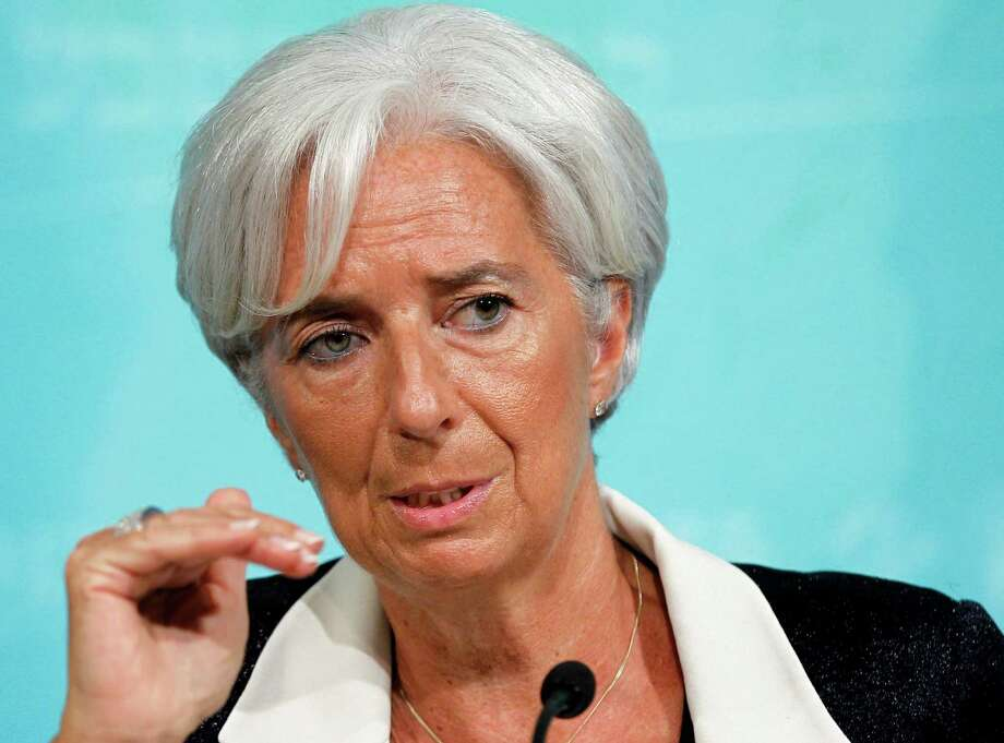 FILE - This July 3, 2012 file photo shows International Monetary Fund Managing (IMF) Director Christine Lagarde speaking in Washington. Lagarde travels the world trying to keep the global economy on track. But some of the greatest threats are brewing just blocks from her Washington office. And there's little she can do about them. The IMF has been left largely on the sidelines as Democratic and Republicans fights over the budget raise the specter of a U.S. default or possibly drive the country into recession. (AP Photo/Haraz N. Ghanbari, File) Photo: Haraz N. Ghanbari