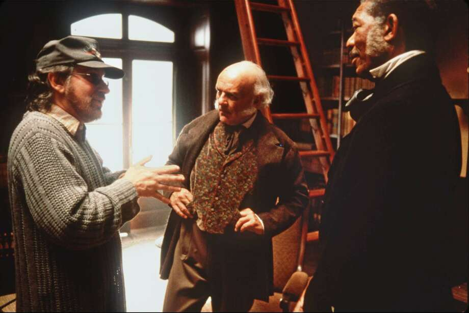 Director Steven Spielberg discusses a scene with actors Anthony Hopkins, center,  and Morgan Freeman on the set of DreamWorks Pictures' 'Amistad,' scheduled to open Dec. 10, 1997.  DreamWorks is accused of stealing the story for the slave ship epic and a federal judge will hear arguments Monday on whether he should block Wednesday's release. (AP Photo/Andrew Cooper, Dreamworks, HO) Photo: ANDREW COOPER / DREAMWORKS