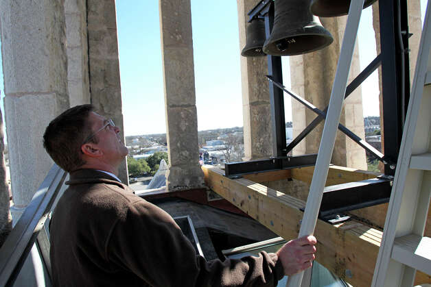 Comal County Judge Sherman Krause takes a look at the bells in the tower as he tours the restored courthouse. Photo: Tom Reel, San Antonio Express-News / ©2012 San Antono Express-News