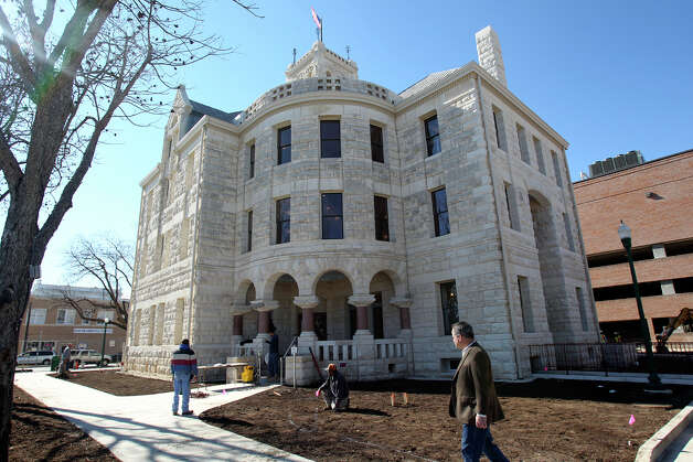 Landscape work is being done at the restored courthouse. Photo: Tom Reel, San Antonio Express-News / ©2012 San Antono Express-News