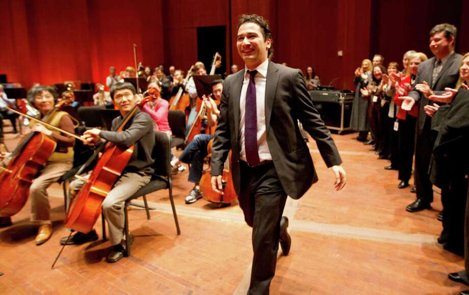 Andrés Orozco-Estrada walks on stage Wednesday at Jones Hall to the applause of the Houston Symphony after being named music director. At 35, he'll also be among the youngest conductors of a major U.S. orchestra. Photo: Karen Warren, Staff / © 2013 Houston Chronicle