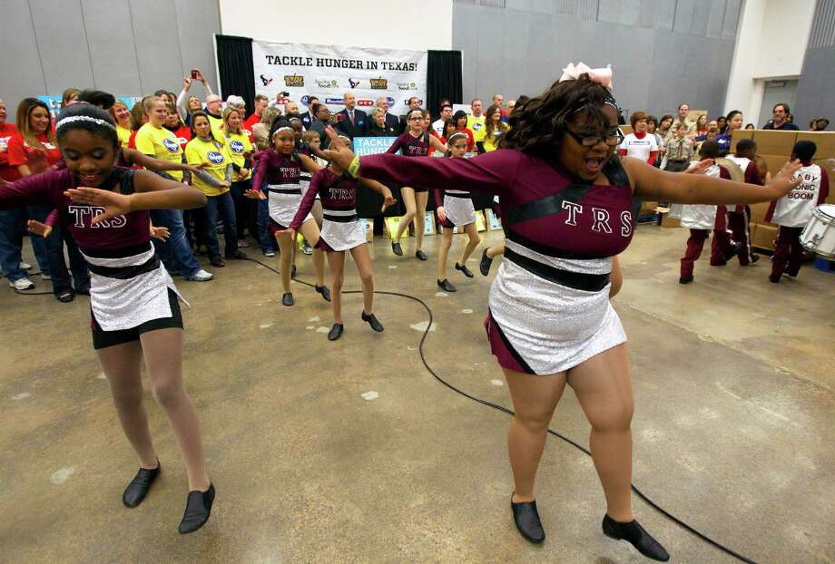 Students from The Rhodes School dance during the kick off of Souper Bowl of Caring 2013 at the Houston Food Bank. Photo: Cody Duty, Houston Chronicle / © 2012 Houston Chronicle