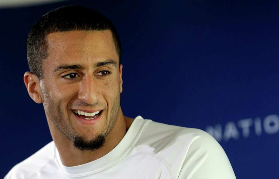 San Francisco 49ers quarterback Colin Kaepernick speaks at an NFL football media availability in Santa Clara, Calif., Wednesday, Jan. 16, 2013. The 49ers are scheduled to face the Atlanta Falcons in the NFC championship game on Sunday. (AP Photo/Jeff Chiu) Photo: Jeff Chiu