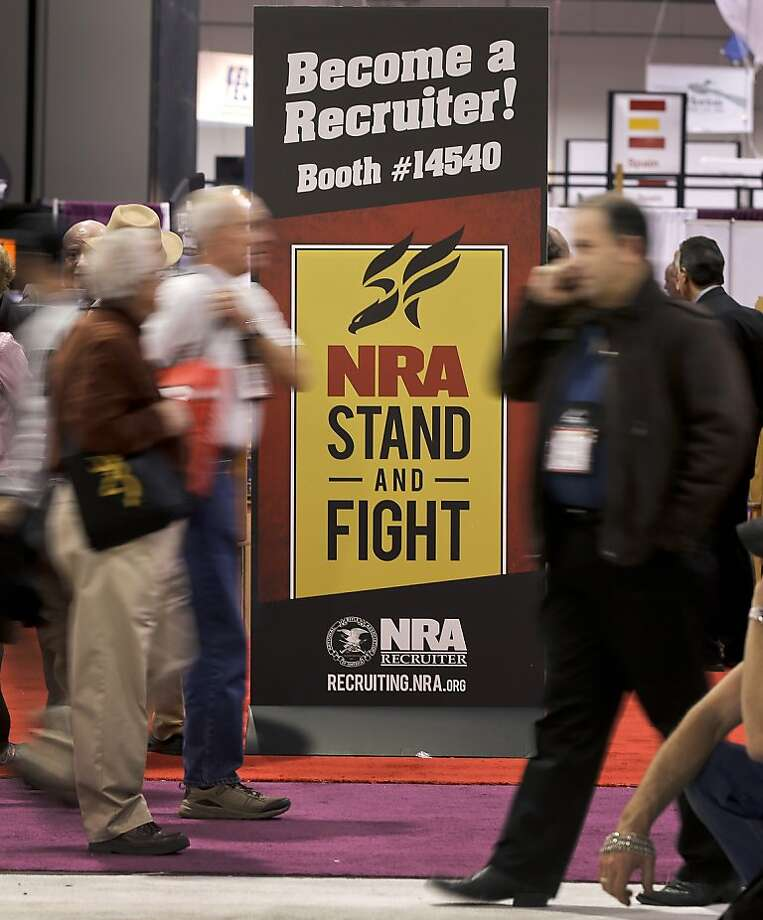 The National Rifle Association booth at a major gun trade show in Las Vegas expresses a message of defiance. Photo: Julie Jacobson, Associated Press