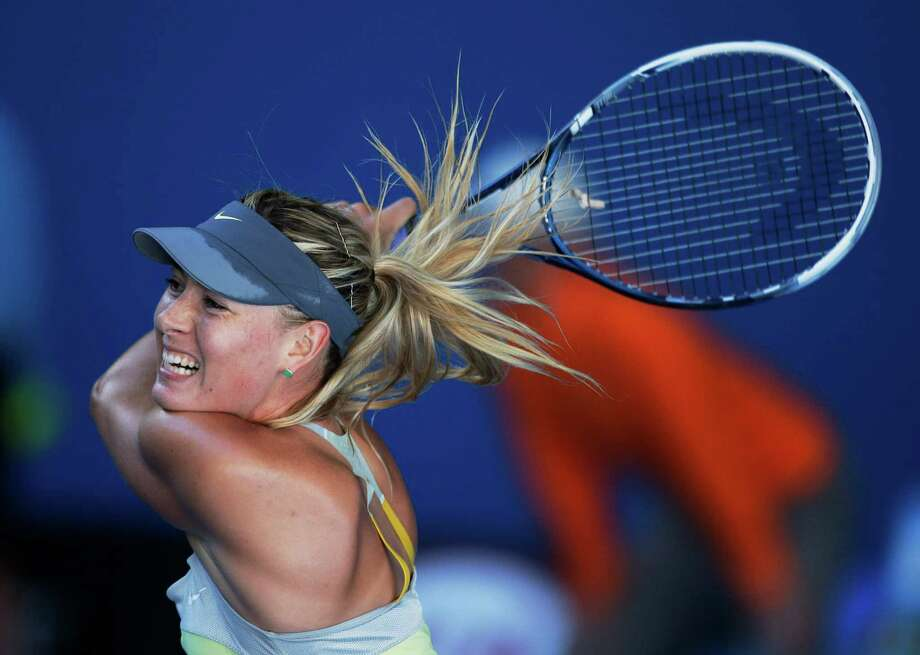 Russia's Maria Sharapova hits a return to Japan's Misaki Doi during their second round match at the Australian Open tennis championship in Melbourne, Australia, Wednesday, Jan. 16, 2013. (AP Photo/Rob Griffith) Photo: Rob Griffith