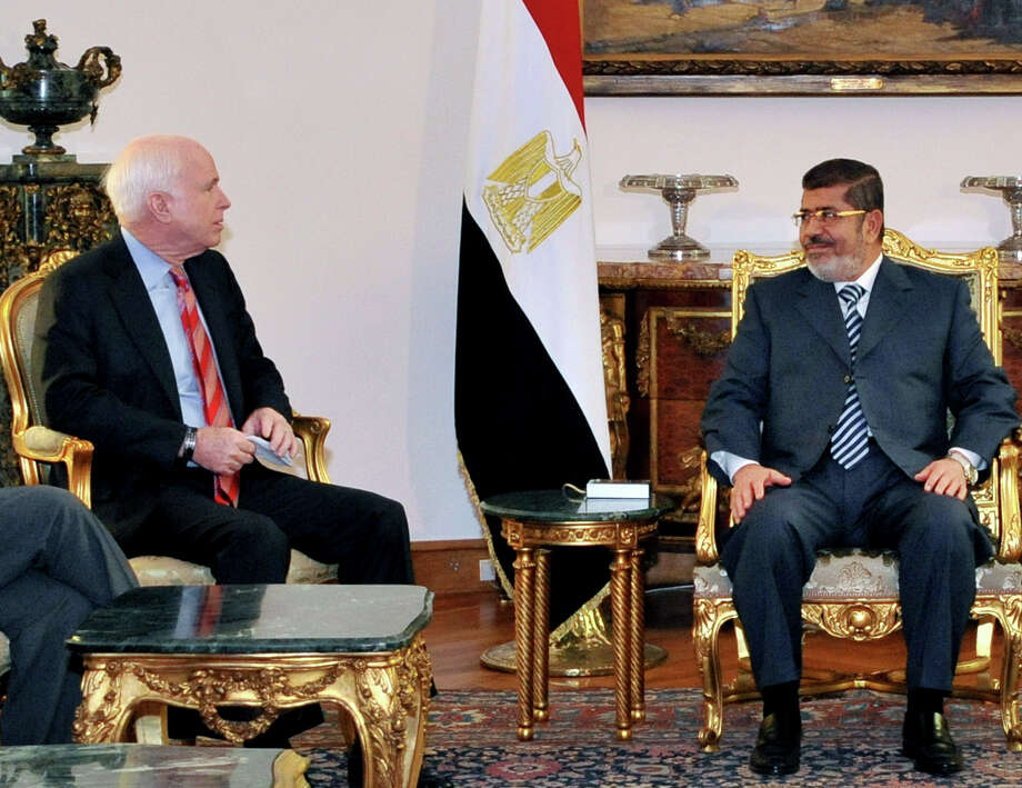 In this image released by the Egyptian Presidency, Egyptian President Mohammed Morsi, right, meets with Republican Sen. John McCain, at the Presidential Palace in Cairo, Egypt, Wednesday, Jan. 16, 2013. Morsi met with McCain in Cairo on Wednesday, for a visit expected to last three days. The meeting comes after the Obama administration on Tuesday gave a blistering review of remarks that the Egyptian President made almost three years ago about Jews and called for him to repudiate what it called unacceptable rhetoric. (AP Photo/Egyptian Presidency) Photo: Uncredited