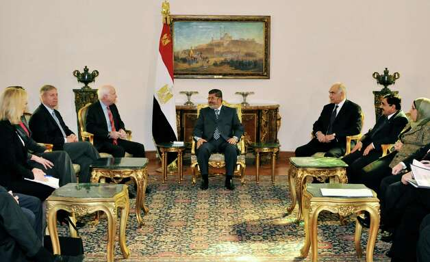 In this image released by the Egyptian Presidency, Egyptian President Mohammed Morsi, center, meets with Republican Sen. John McCain, center left, at the Presidential Palace in Cairo, Egypt, Wednesday, Jan. 16, 2013. Morsi met with McCain in Cairo on Wednesday, for a visit expected to last three days. The meeting comes after the Obama administration on Tuesday gave a blistering review of remarks that the Egyptian President made almost three years ago about Jews and called for him to repudiate what it called unacceptable rhetoric. (AP Photo/Egyptian Presidency) Photo: Uncredited