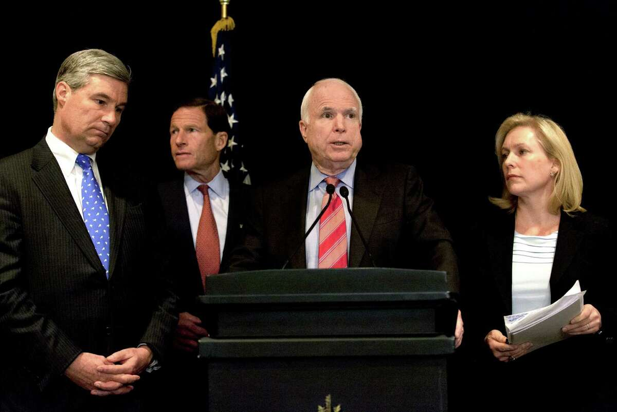 From left, Senators, Sheldon Whitehouse, Democrat from Rhode Island, Richard Blumenthal, Democrat from Connecticut, John McCain, Republican from Arizona and Kristen Gillibrand, Democrat from New York, attend a press conference for a delegation from the United States Senate, in Cairo, Egypt, Wednesday, Jan. 16, 2013.