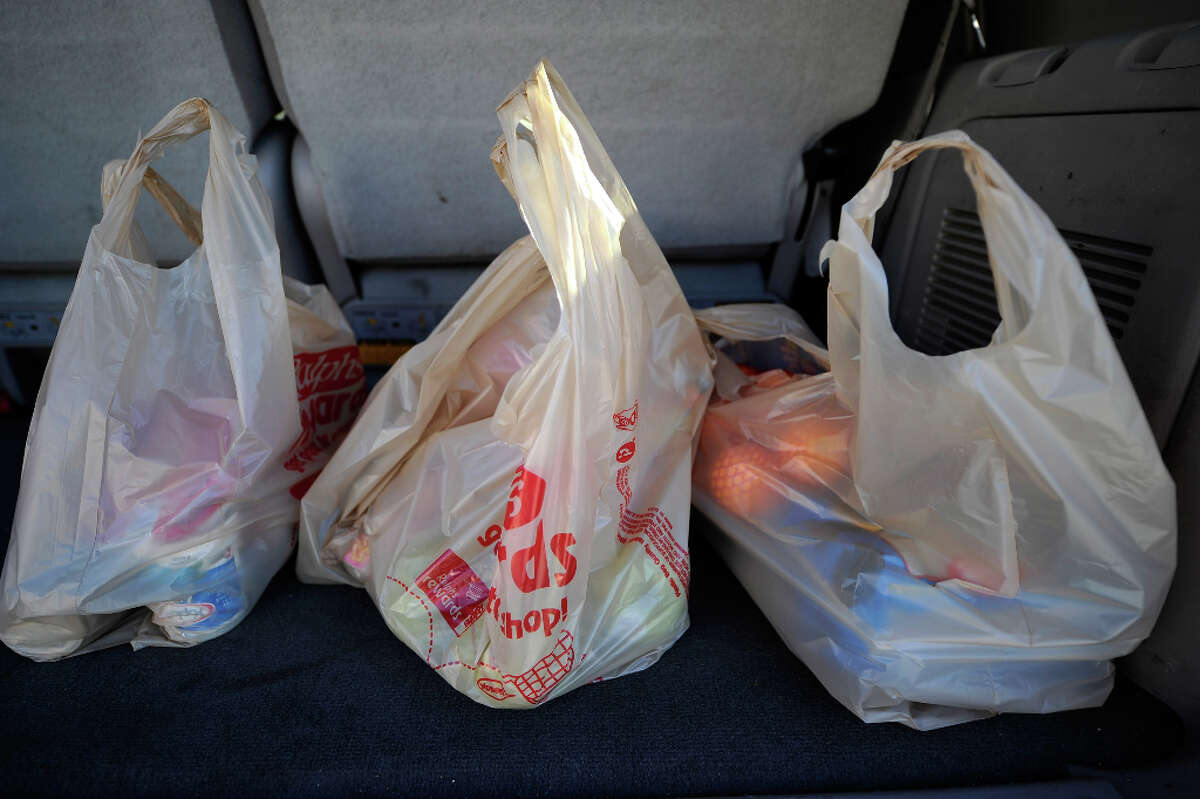 Many stores still use plastic bags, in the form of thicker, heavy-weight bags allowed in the law. (The disposable ones in the photo are banned). Of stores surveyed, 20 percent said they give out thicker bags, sometimes for 5 cents.