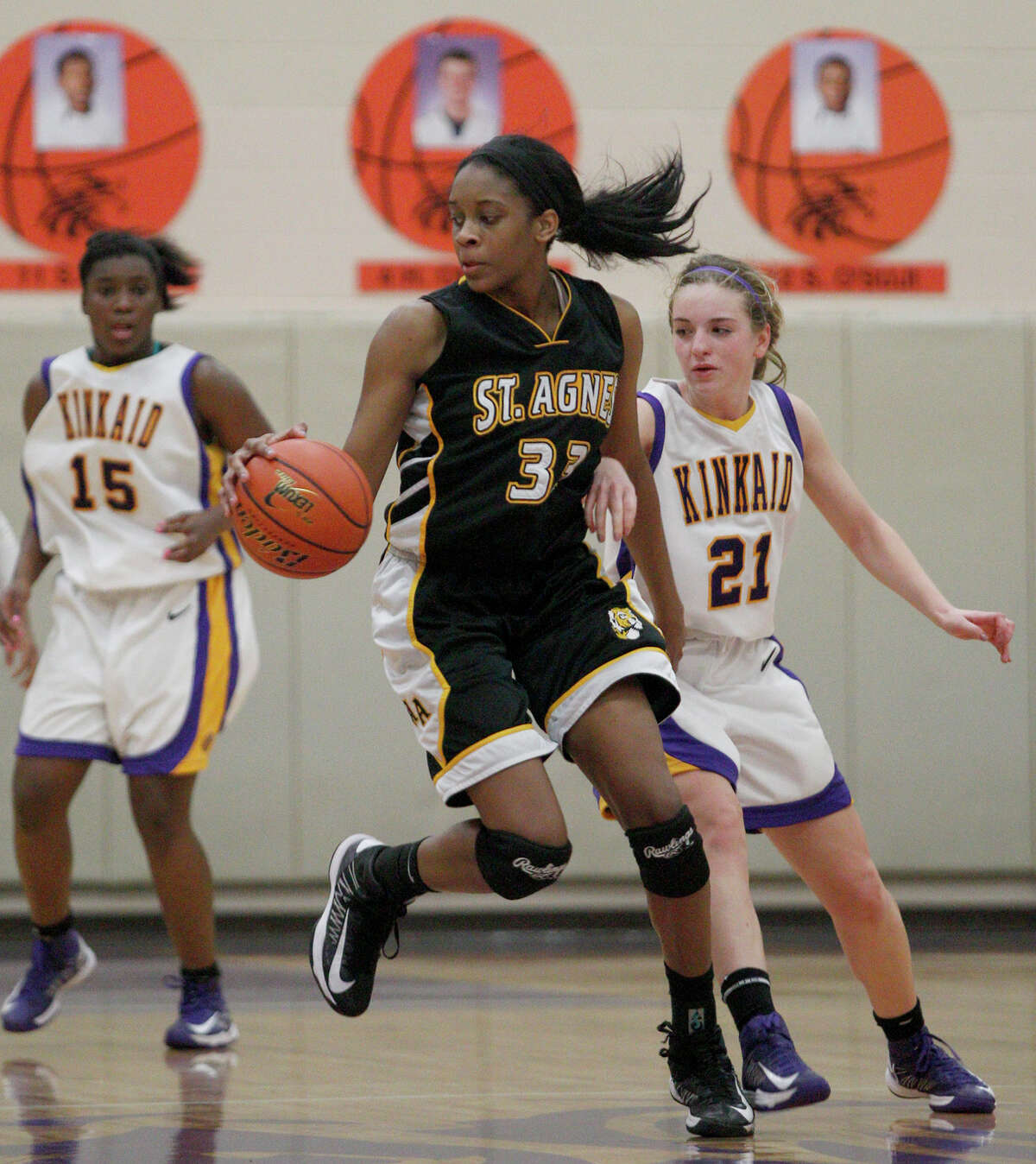 1/8/12: St Agnes Tigers Michelle Nwokedi (33) spins and dribbles around Kinkaid Falcons Maddie Holmes (21) in the second half at Kinkiad High School in Houston, Texas.
