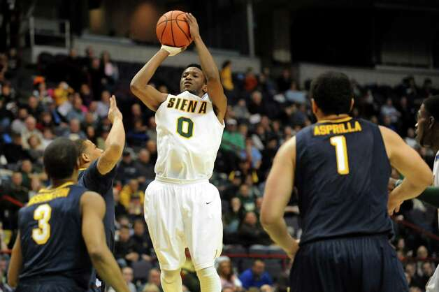 Siena's Rich Audu (0), center, shoots for the hoop during their basketball game against Canisius on Friday, Jan. 11, 2013, at Times Union Center in Albany, N.Y. (Cindy Schultz / Times Union) Photo: Cindy Schultz / 00020599C