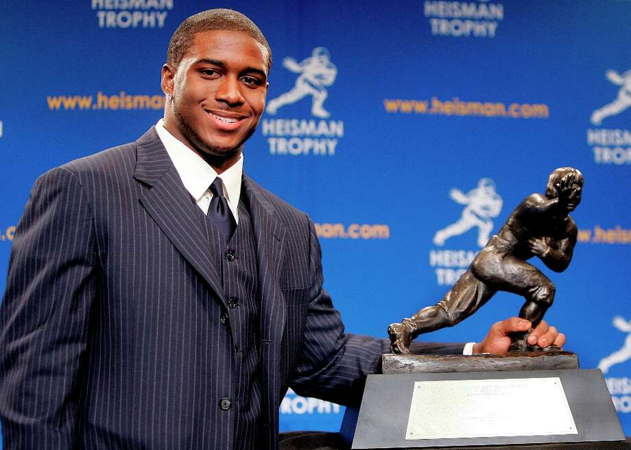 2010 | Reggie Bush returns Heisman Trophy; USC is hit with sanctionsReggie Bush (pictured) led the USC Trojans to the national championship in 2005 as a star running back, won the Heisman Trophy and was taken second overall in the 2006 NFL Draft. But reports soon surfaced that he and others received improper benefits at USC, and in 2010 Bush ended up voluntarily forfeiting his Heisman award. The NCAA penalized USC hard, vacating its championship season and banning the Trojans from the postseason for two years. Photo: Stephen Chernin, Getty Images / 2005 Getty Images