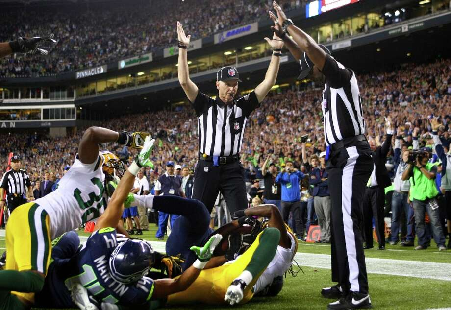 2012 | NFL's replacement refs and the 'Fail Mary' touchdownThe NFL, having locked out its regular officials during a labor dispute, used replacement refs through the first three weeks of the 2012 season -- and football fans were not pleased. The outcry came to a head when replacement officials called a controversial touchdown on the last play of a ''Monday Night Football'' game between the Seahawks and Packers on Sept. 24 in Seattle  -- a Hail Mary pass from quarterback Russell Wilson to receiver Golden Tate that, on replays, appeared to have been intercepted by Green Bay safety M.D. Jennings. The Seahawks won 14-12 and the controversy prompted a settlement between the NFL and its regular officials. Photo: JOSHUA TRUJILLO / SEATTLEPI.COM