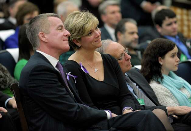 Lynn and Chris McDonnell, parents of Grace McDonnell who was killed in the Newtown, Conn. school shooting, listen as President Barack Obama talks about their daughter during a news conference on proposals to reduce gun violence, Wednesday, Jan. 16, 2013, in the South Court Auditorium at the White House in Washington.  (AP Photo/Susan Walsh) Photo: Susan Walsh, Associated Press / AP