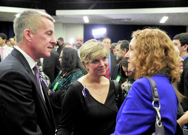 Chris and Lynn McDonnell, parents of Grace McDonnell, who was killed at the Sandy Hook Elementary School shooting talk with Rep. Elizabeth Esty. United States President Barack Obama and Vice President Joe Biden made remarks at an event at the White House in Washington, D.C. to unveil a set of proposals to reduce gun violence on Wednesday, January 16, 2012. Photo: Ron Sachs, Ron Sachs - CNP / ©2013 Ron Sachs from Consolidated News Photos All Rights Reserved Connecticut Post contributed