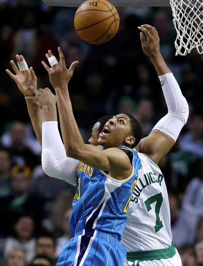 New Orleans Hornets power forward Anthony Davis (23) grabs a rebound against Boston Celtics power forward Jared Sullinger (7) during the first quarter of an NBA basketball game in Boston, Wednesday, Jan. 16, 2013. (AP Photo/Elise Amendola) Photo: Elise Amendola