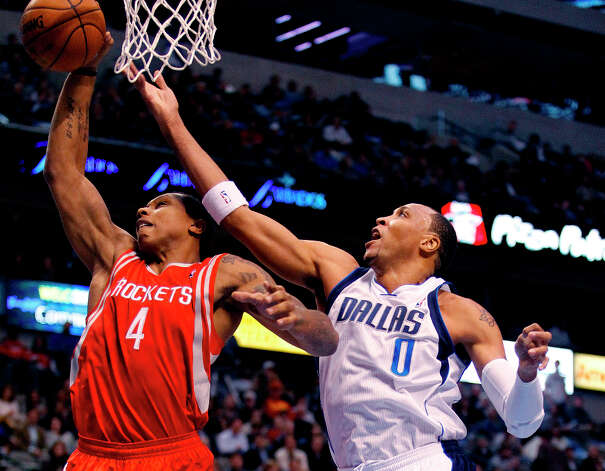 Jan. 16: Mavericks 105, Rockets 100Rockets power forward Greg Smith blocks a first-half shot by Mavericks small forward Shawn Marion. Photo: Paul Moseley, McClatchy-Tribune News Service / Fort Worth Star-Telegram