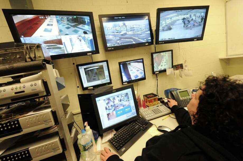 School security officer Stefanie Allen watches surveillance cameras that cover all of the Albany School Districts Schools from a office at Albany High School on Wednesday Jan. 16,2013 in Albany, N.Y. (Michael P. Farrell/Times Union) Photo: Michael P. Farrell