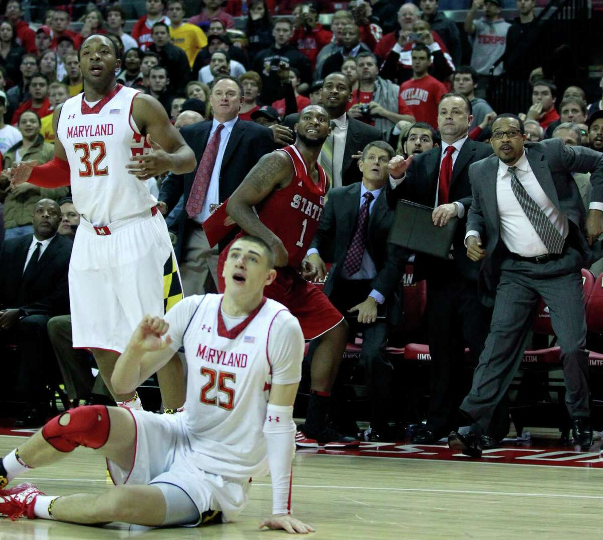 All eyes are on the last-second shot by North Carolina State's Richard Howell (1), which failed to fall, allowing Maryland to escape with a one-point win.