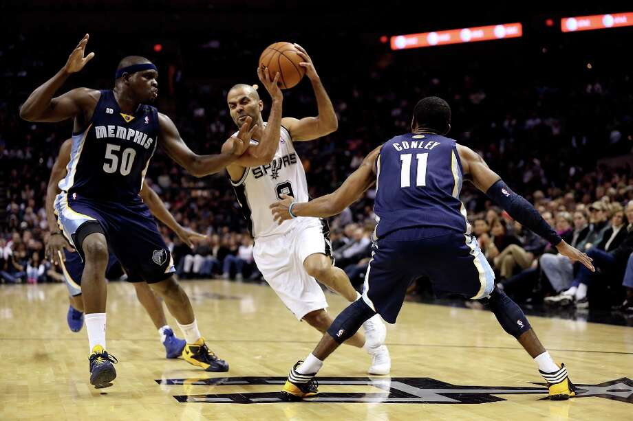 San Antonio Spurs' Tony Parker drives through Memphis Grizzlies' Zach Randolph and Mike Conley during the first half at the AT&T Center, Wednesday, Jan. 16, 2013. Photo: Jerry Lara, San Antonio Express-News / © 2013 San Antonio Express-News