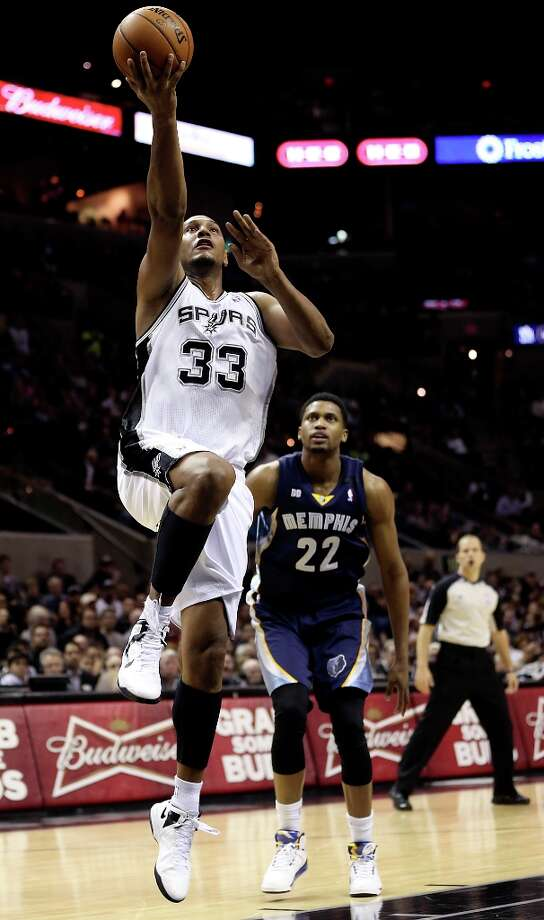 San Antonio Spurs' Boris Diaw score over Memphis Grizzlies' Rudy Gay during the first half at the AT&T Center, Wednesday, Jan. 16, 2013. Photo: Jerry Lara, San Antonio Express-News / © 2013 San Antonio Express-News